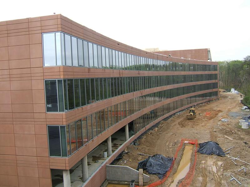 Back wing of NCWCP; windows are installed every where except for deli area on first floor.