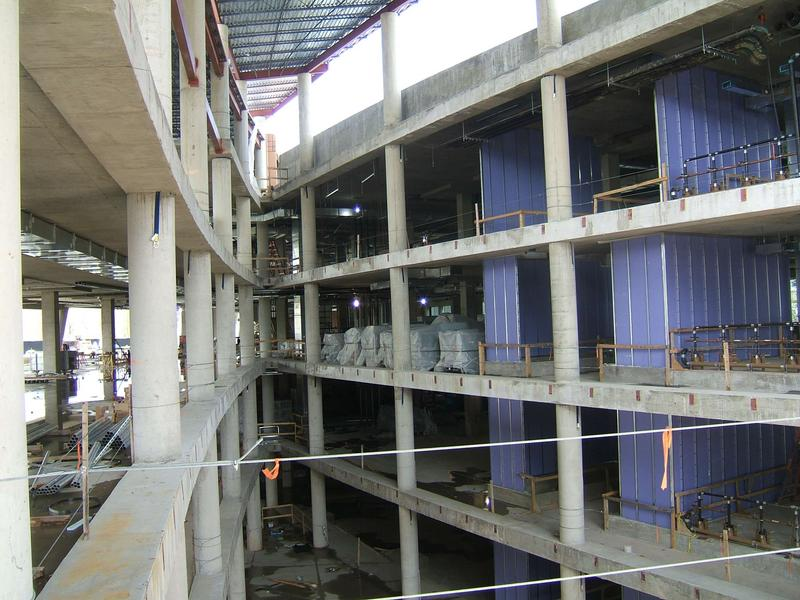 Interior of atrium. Blue walls to right enclose the elevators