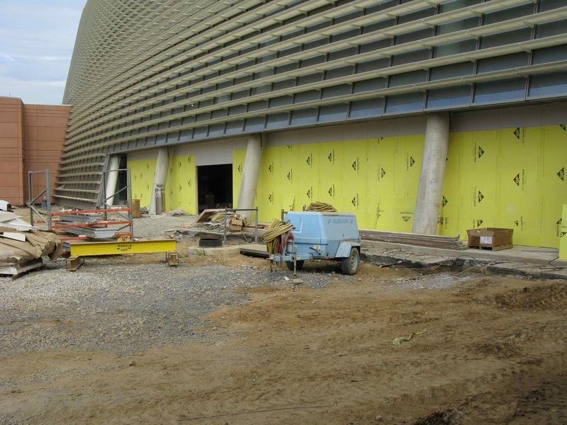Another view of the entrance; yellow walls are temporary