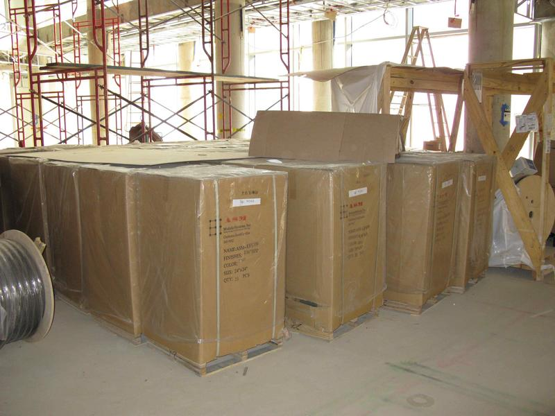 Boxes of raised flooring panels stored in the atrium