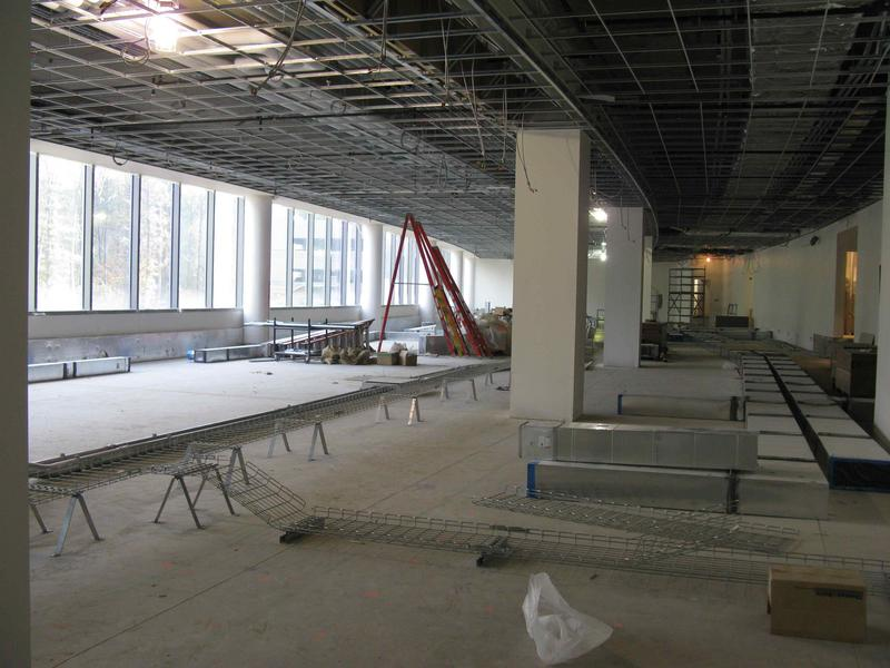 NCO office area on first floor showing ductwork to be located under the raised flooring