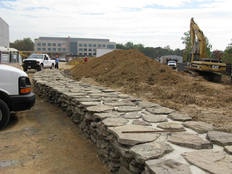 Fieldstone wall across from building entrance. UMD building is in the background