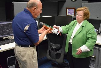 U.S. Senator Barbara Mikulski discusses a dropwindsonde instrument with CARCAH chief John Pavone.