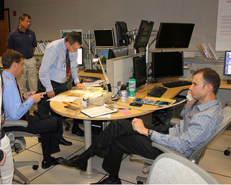 National Hurricane Center Storm Surge Team Leader (seated at right) discusses the storm surge risk with NWS WFOs during a coordination conference call as Sandy approaches the Northeast U.S. coastline.