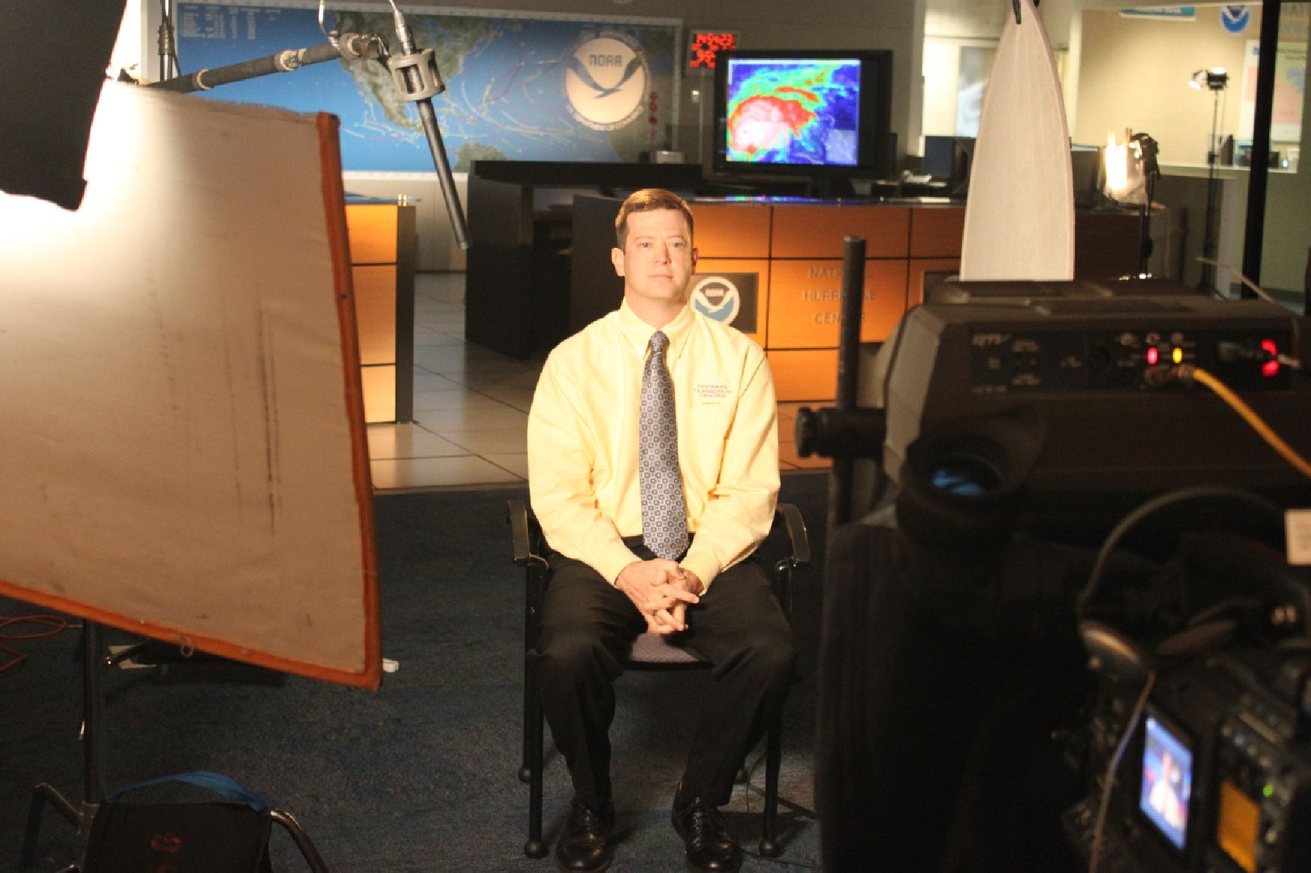 NHC WCM and senior hurricane specialist Daniel Brown prepares to record one of the PSAs regarding hurricane preparation.