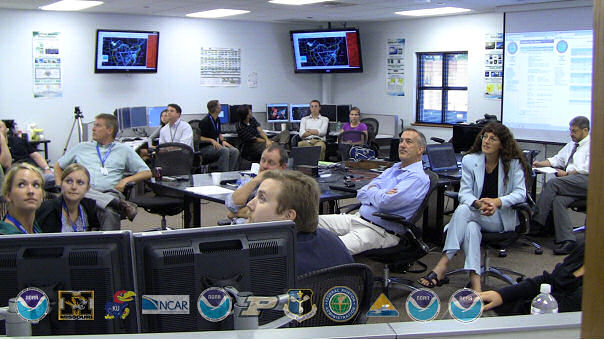 Participants engaged in Aviation Weather Testbed Summer Experiment. In the foreground on the right is Ellen King, Director of FAA Systems Operations. To her right is Kevin Johnston, the FAA Air Traffic Control System Command Center (ATCSCC) Chief Meteorologist.