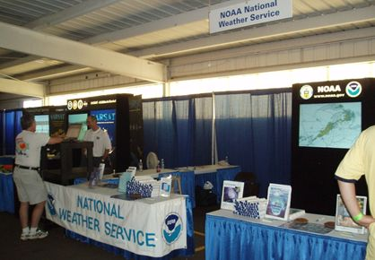 Meteorologists answering pilot questions at the NOAA booth.