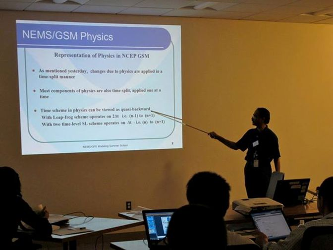 Image 2: Dr. Shrinivas Moorthi gives the students an introduction to the physics inside the NEMS/GFS. (Credit: Nicole McKee, IMSG/EMC).