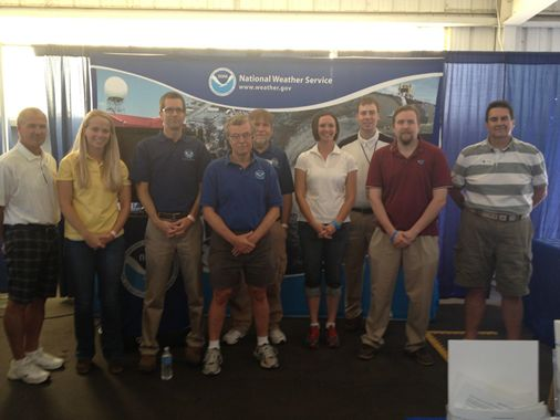 Figure 1. NWS staff in front of the NOAA booth in the Federal Pavilion.